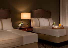 two queen beds in a hotel room at la cantera