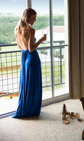 woman holding glass of wine near a window