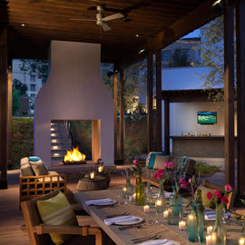 outdoor dining table with fireplace