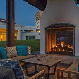 outdoor seating area with large fireplace