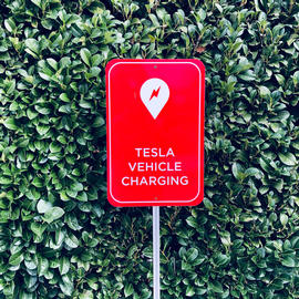 sign for a tesla charging station